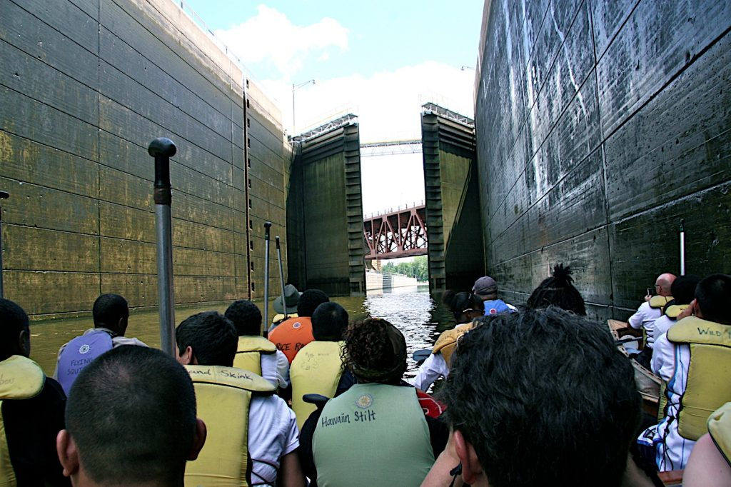 Traversing the Upper St. Anthony Falls Lock in 2010, with a view of the Stone Arch Bridge. The lock is now closed to traffic. Image courtesy of Greg Lais.