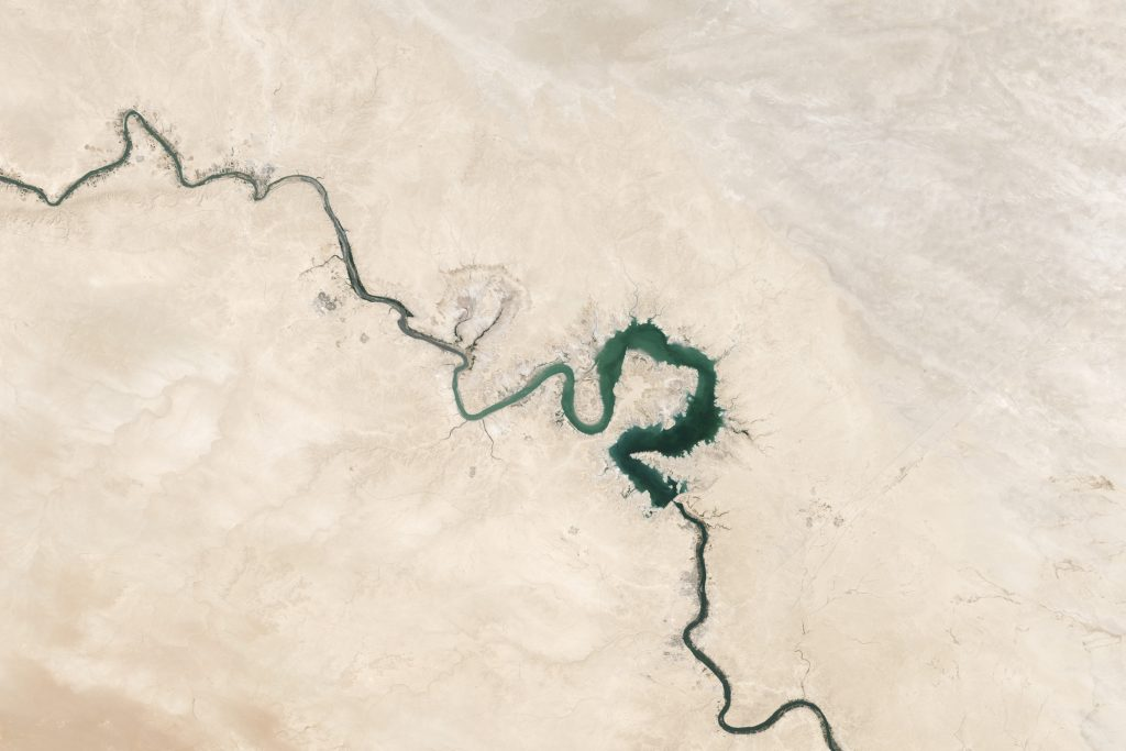 Qadisiyah Reservoir on the Euphrates River, Iraq. This image, taken in 2009, shows the reservoir at less than half its size in 2003 due to human consumption of water for drinking and agriculture.