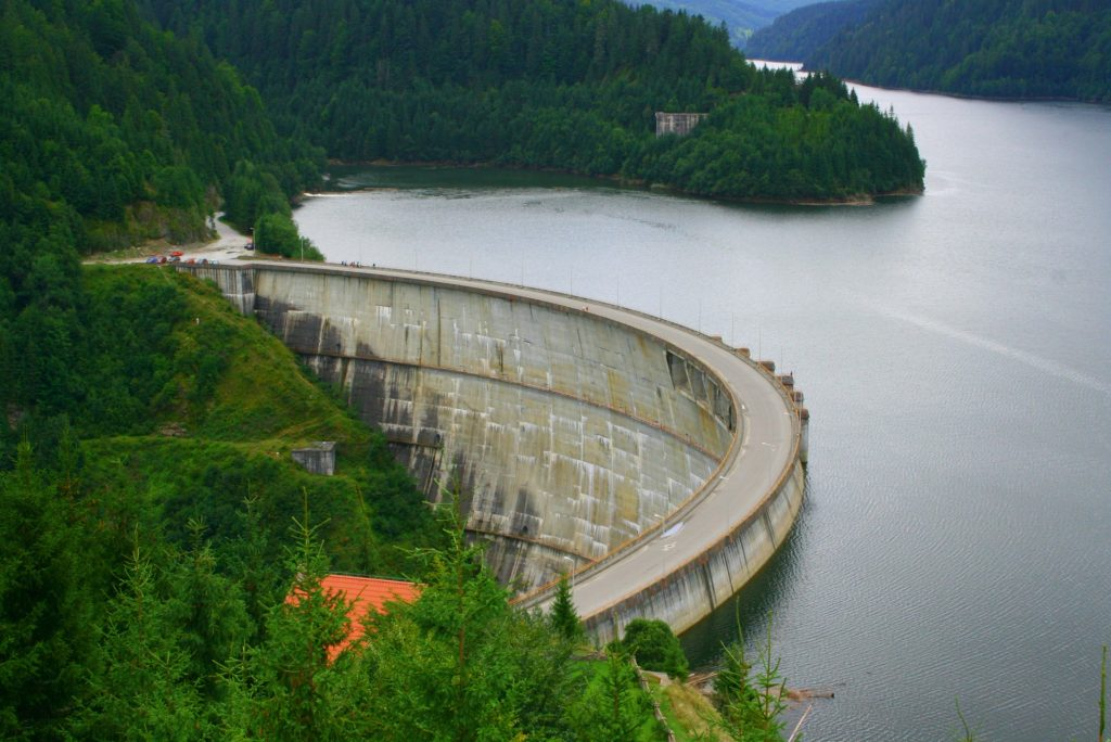 Dragan Dam in Romania. The dam is surrounded by lush trees.