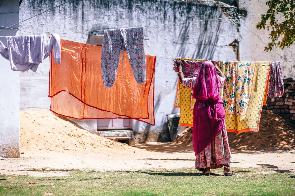 Hanging wet clothes to dry in Pushkar, India. In 2010, the United Nations formally declared a human right to water and sanitation for basic needs.