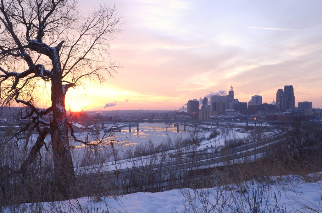 The sun sets upon St. Paul, MN from the beloved Indian Mounds Park bluff top view.