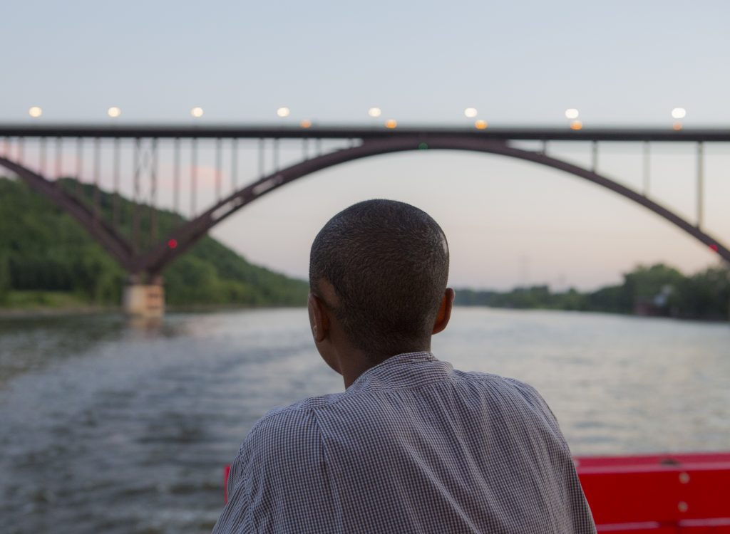 A paddleboat passenger enjoying the Big River and St. Paul's iconic High Bridge.