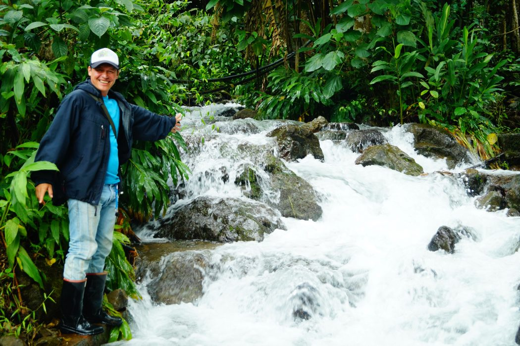 Baudelino Rivero shows one of the streams under protection of the Asobolo watershed organization. He visits this point in a weekly basis as part of his duties helping to monitor water quality. Image courtesy of Kelly Meza Prado.