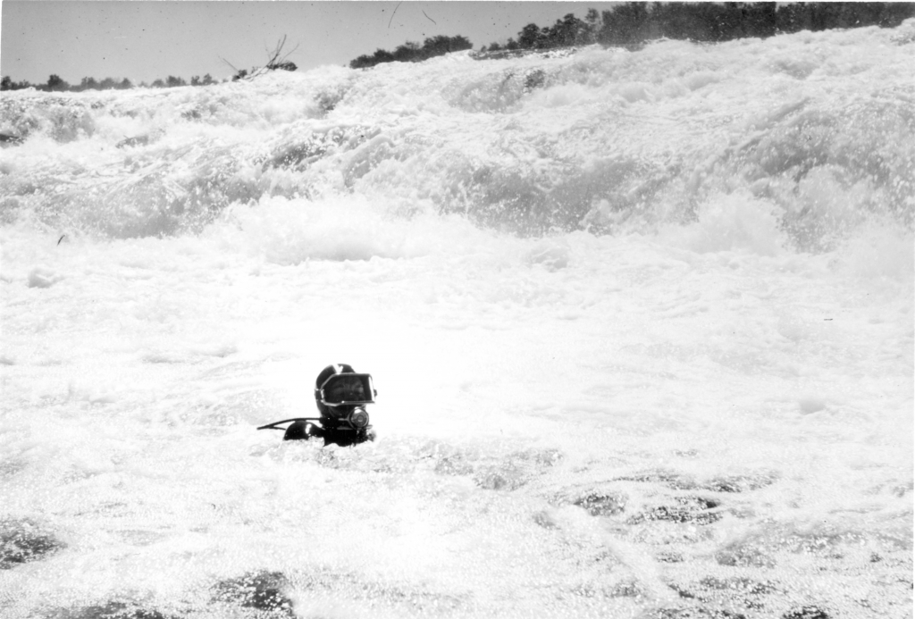 Figure 9. One of the divers in the white waters of the Namakan River, Ontario.