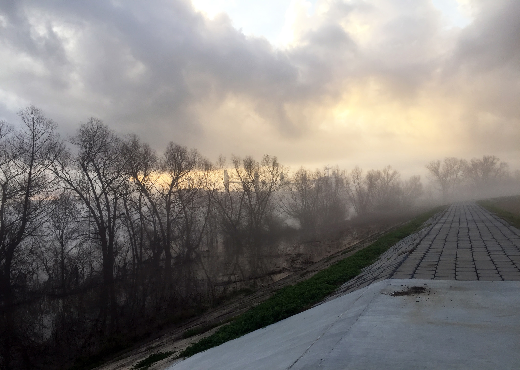 A picture of a levee on a foggy day.