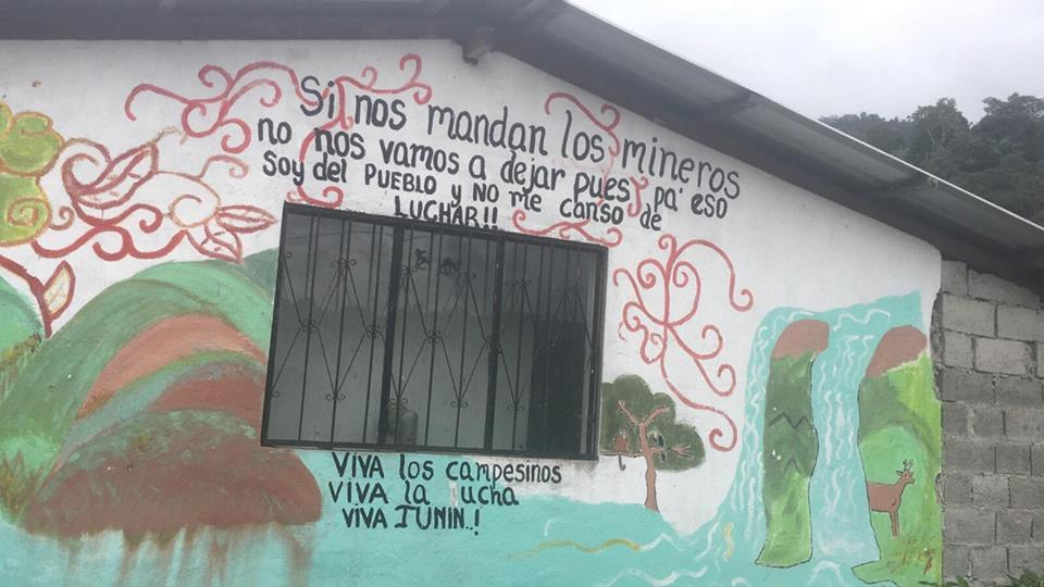 Pro-campesino/anti-mining protest art on a community building in Junín , Ecuador. The message roughly translates to 'If the miners try to rule over us, we're not going to leave because that is why I am part of my people and I do not get tired of fighting! Long live the farmers, long live the fight, long live Junín!'