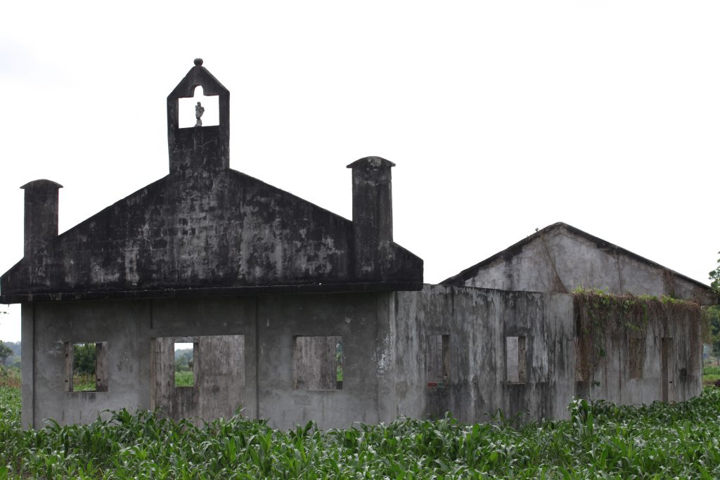 Abandoned church on the banks of the Chixoy River, Guatemala. The original location of the village was abandoned after several hurricanes destroyed most of the dwellings. Now families live on Maya ruins that stay above the floodline, even during the worst floods. Image courtesy of the author.