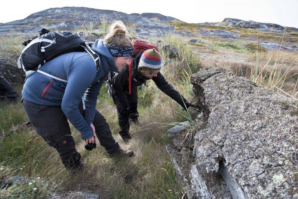During the REMAINS of Greenland project, scientists have visited 14 different archaeological sites in the Nuuk region. Here the state of preservation is being evaluated at the heavily eroded site of Nuugaarsuk. Image courtesy of Roberto Fortuna, National Museum of Denmark.