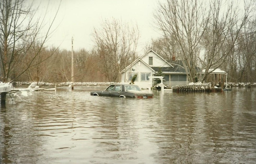 Flooding of Laurie's home—the oldest house at this location—as well as a vehicle that was not able to be taken out before the flooding. Image courtesy of Alex Blue.