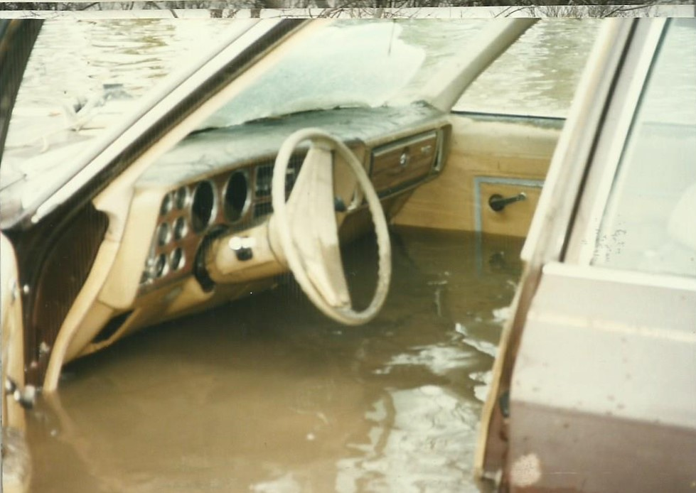 Close-up photo of the flood waters in the vehicle. The water is almost at the same height as the bottom of the steering wheel. Image courtesy of Alex Blue.