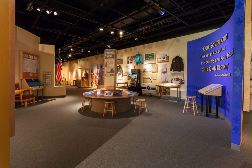 Mille Lacs Indian Museum, 2012. Image depicts interior of museum, full of different photos and artifacts. Image courtesy of Brady Willette and Minnesota Historical Society.