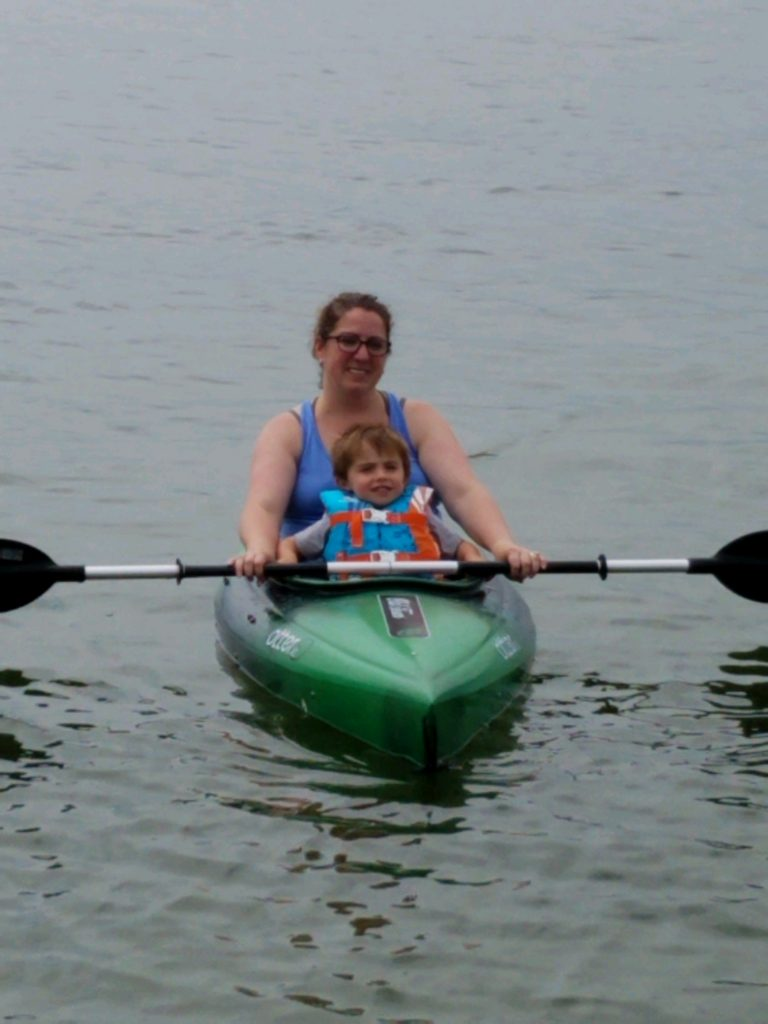 Anna Peterson, University of Minnesota Extension, and her son Vincent enjoy a moment on Big Floyd Lake near Detroit Lakes, Minnesota. Image courtesy of Glenece Hanson.