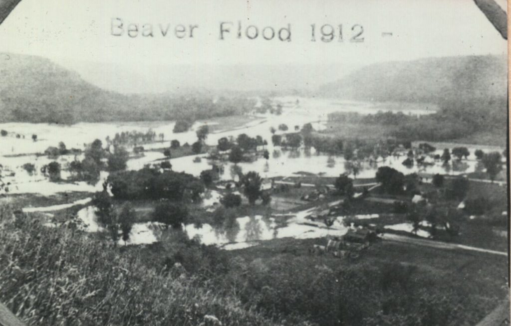 Beaver Village flood in 1912. It is clear that that there is a lot of water where houses and roads used to be.