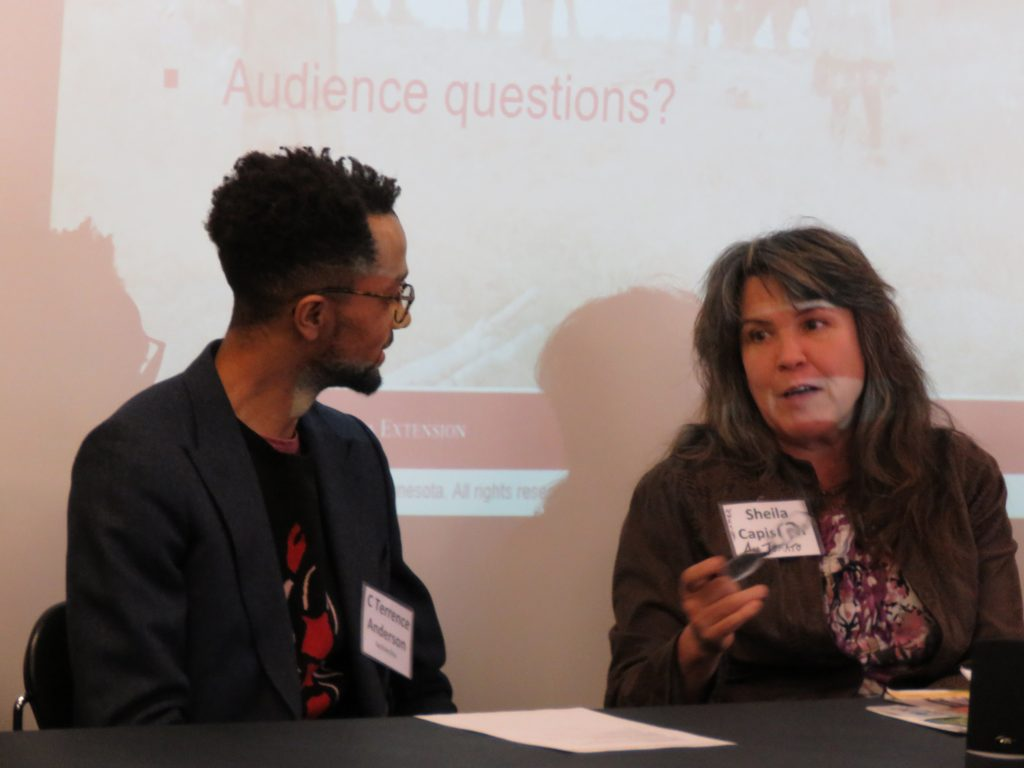 heila Capistran, NWRSDP board member, and C Terrence Anderson, Center for Urban and Regional Affairs (CURA) staff, share perspectives at a Statewide Coordinating Committee meeting. Image courtesy of Caryn Mohr.