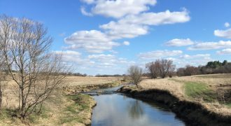 Tipton Creek runs through the community that the author's family calls home. This water winds through farmland, eventually connecting to the Iowa River, a tributary of the Mississippi River. Image courtesy of the author.
