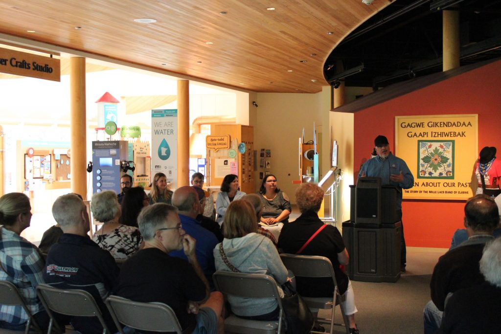Travis Zimmerman welcoming guests to the Mille Lacs Indian Museum opening event.