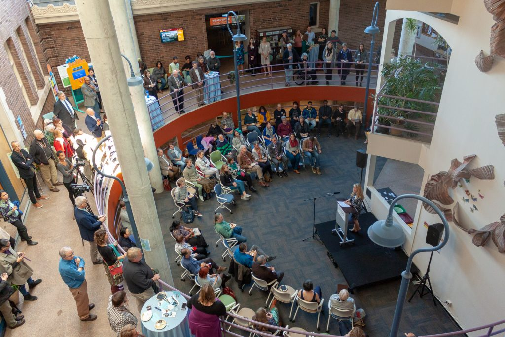 The opening ceremony for the We Are Water MN exhibit at UMN Twin Cities featured speakers in the atrium adjacent to the exhibit itself.
