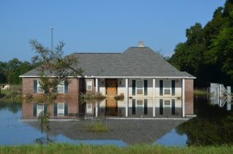 Figure 4. Slab-on-grade house that flooded, Flood water is shown surrounding the house and coming all the way up to the structure. Ascension Parish. August 2016. Image courtesy of the author.