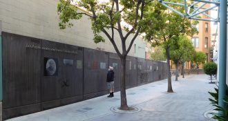 Photograph of a wall embedded with text and objects from Biddy Mason park, a surprising 'pocket park' in downtown LA honoring Mason who was moved to California as a slave in 1850, was freed, and became a successful midwife and landowner. Image courtesy of Don Barrett (CC BY-NC-ND 2.0).