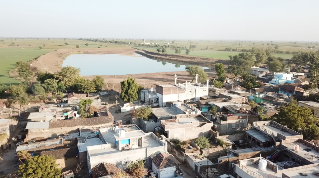 View of Dhamori and the village pond. Image courtesy of the author.
