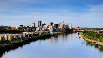 The urban Mississippi River flowing by downtown Saint Paul. Image courtesy of Nattapol Pornsalnuwat.