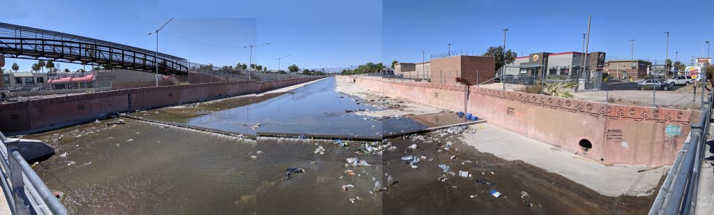 A flood control channel within the city, collecting trash. Image courtesy of the author.