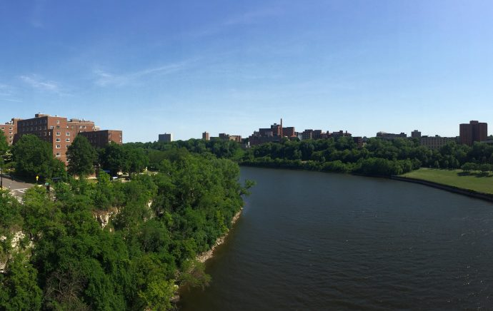 Detail from original. Between the east and west banks of the University of Minnesota Twin Cities campus, as taken from the Washington Avenue Bridge. Image courtesy of Vicente M. Diaz.