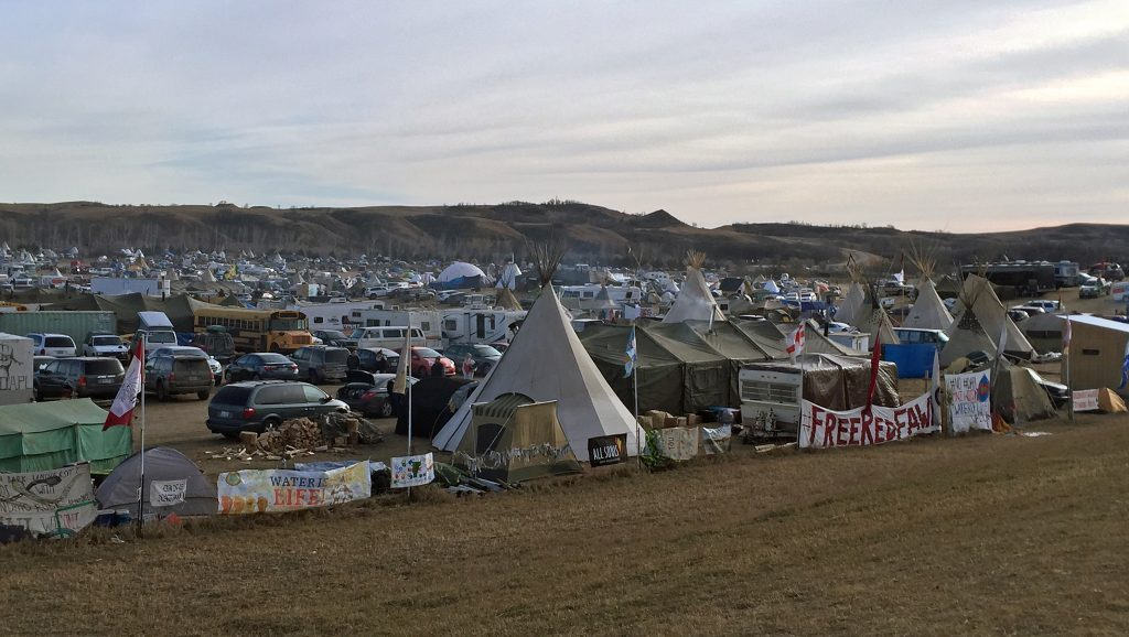 Signs in front of Oceti Sakowin Camp, Camp Red Fawn, Standing Rock, Dakota Access Pipeline protests, 2016. CC BY 2.0. Image by Becker1999 (Paul and Cathy), Flickr.Signs in front of Oceti Sakowin Camp, Camp Red Fawn, Standing Rock, Dakota Access Pipeline protests, 2016. CC BY 2.0. Image by Becker1999 (Paul and Cathy), Flickr.