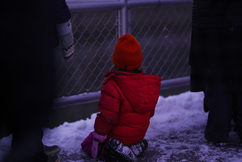 Child watching the animation through fence holes at the edge of the lock. Image courtesy of Nedahness Greene.