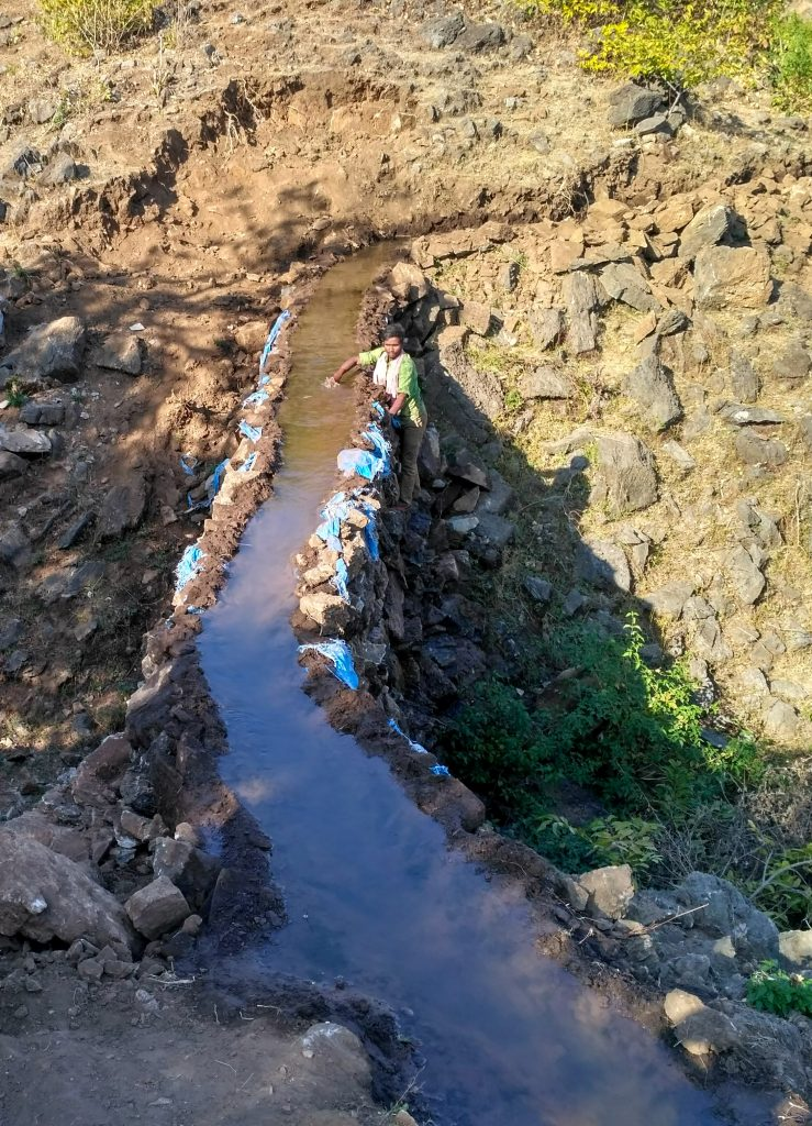 Figure 1: A dhora cuts across a natural drainage in Karech. Torrential rains and consequent high flow in the channels often destroy these structures and they have to be constructed again. Image courtesy of the author.