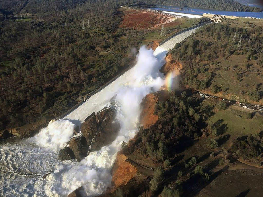 This aerial photo, released by the California Department of Water Resources, shows the damaged spillway with eroded hillside in Oroville California during the dam crisis in 2017 during which the dam threatened collapse. This crisis remains emblematic of greater issues of water security globally and in California. Image by William Croyle,, California Department of Water Resources.